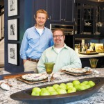 Partners John Larson and Mike Stewart in their kitchen designed by Bonnie Birnhaum and Karen Soojian. Photo by Hubert Bonnet.
