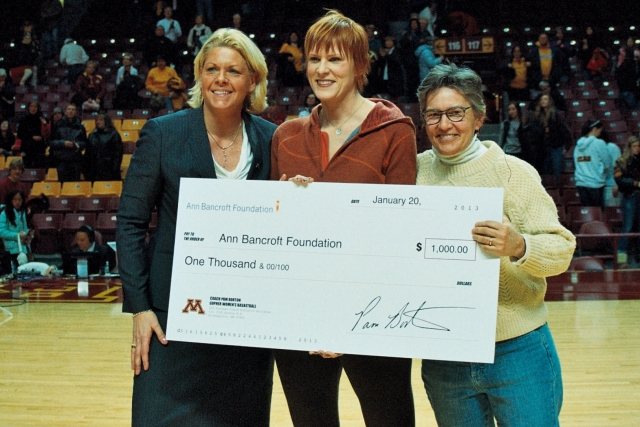 Coach Pam Borton made a $1000 donation to the Ann Bancroft Foundation at the Minnesota Gopher vs Nebraska Cornhuskers &quot;Burst the Barn&quot;  night at Williams Arena. Pictured l-r Pam Borton Coach, Women's Basketball U of M Joanne Grobe  Ann Bancroft Foundation Ann Bancroft  Ann Bancroft Foundation 