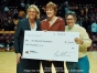 "Coach Pam Borton made a $1000 donation to the Ann Bancroft Foundation at the Minnesota Gopher vs Nebraska Cornhuskers ""Burst the Barn""  night at Williams Arena.  Pictured l-r  Pam Borton Coach, Women's Basketball U of M  Joanne Grobe  Ann Bancroft Foundation  Ann Bancroft  Ann Bancroft Foundation"