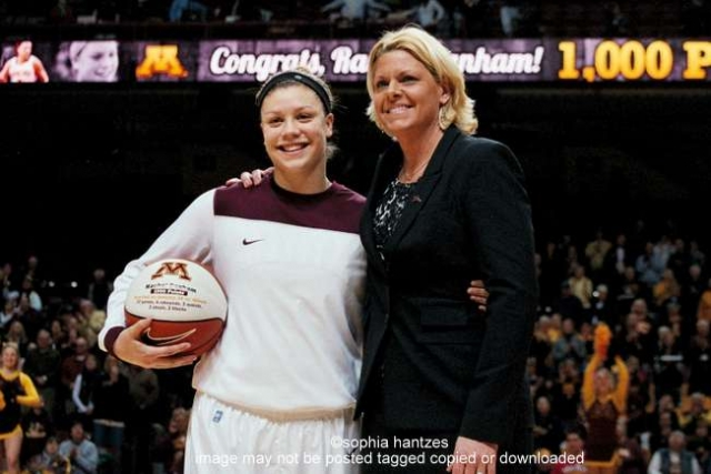 Sophomore Guard Rachel Banham was awarded the game ball for scoring her career 1000th point in the Minnesota vs Illinois game on 01.28.12 Pictured l-r Rachel Banham Coach Pam Borton